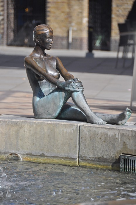 Woman sculpture in Fountain at Tower Bridge Plaza