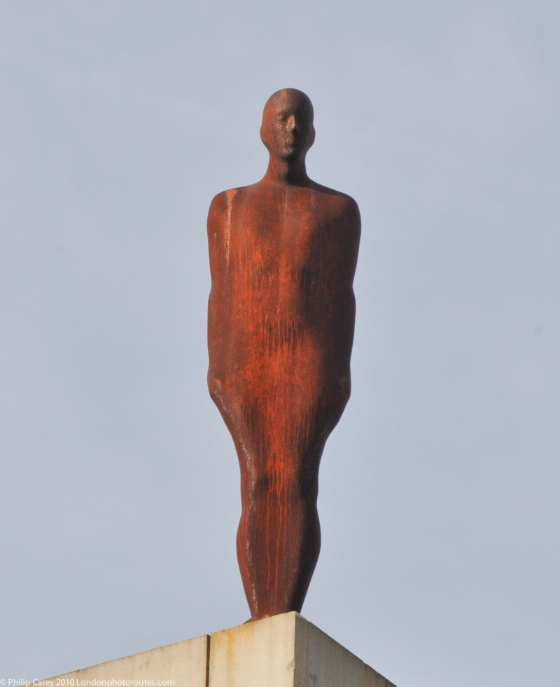 Statue by Antony Gormley, installed on the roof of the Roundhouse