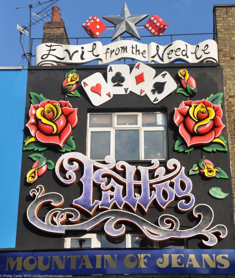 Shopfront art - Camden High Street - Mountain of Jeans