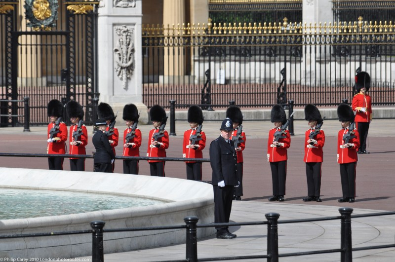 Police and Guards by Queen Victoria's memorial - Trooping of the Colour.