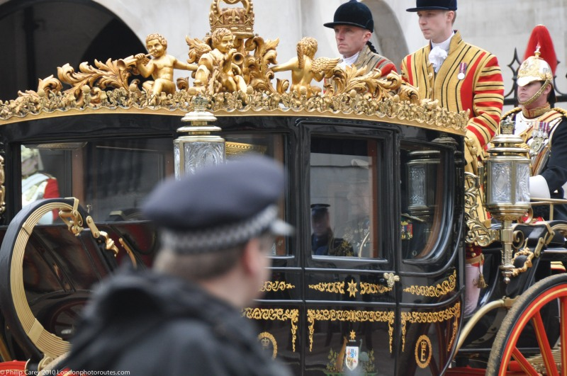 The Queens Coach in Whitehall - watched by the Police