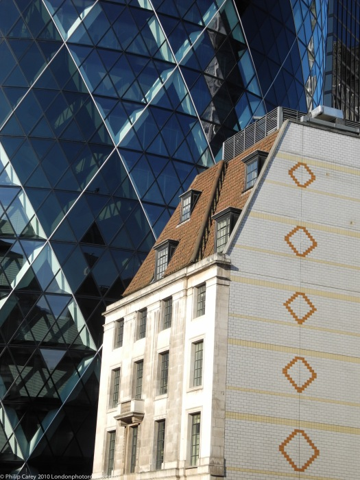 View of the Gherkin 30 St Mary's Axe - detail, and older building