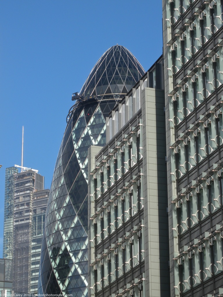 View of the Gherkin 30 St Mary's Axe within the City of London from the street 1