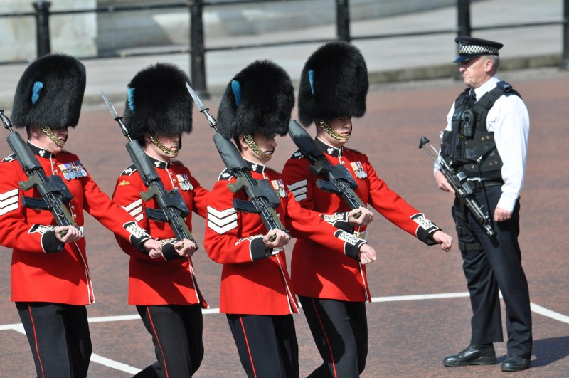 Guards outside Buckingham Palace with Armed Police